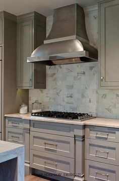 light taupe kitchen; stainless steel range hood