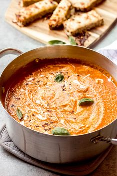 Creamy, rich, and full of flavor. This roasted tomato soup is a family favorite. #tomatosoup #tomatobasilsoup #summersoup