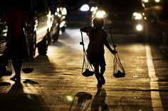 Bandung (Indonesia) - Street Child Carrying Cobek