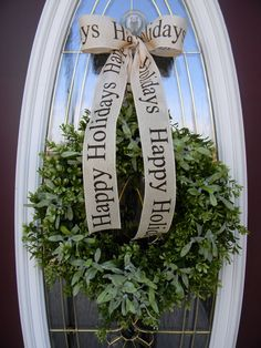 "Christmas Wreath Holiday Door Wreath Decor..""Mistletoe Kisses"". $70.00, via Etsy."