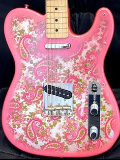 An awesome paisley guitar just like my own personal guitar slinger owns