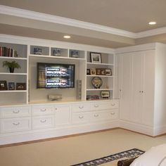 i would LOVE to do this in the living room!! (without the cabinet on the right side)