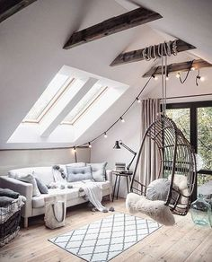 highlight the ceiling with wooden beams and lights and hang a rattan chair
