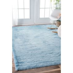 Soft and plush and with pile made from acrylic yarn. NuLOOM rug construction is sturdy and can stand the test of time. This shag area rug makes a fun addition to any fashionable space.