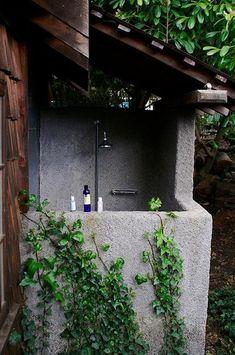 """Bathing en Plein Air: 29 Outdoor Summer Showers"" by Alexa Hotz   Outdoor Concrete Shower at Mankas Inn  "