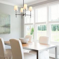 Blue and Gray Dining Room with Stainless Steel and Maple Dining Table