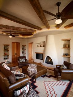 southwest rugs Family Room Southwestern with adobe fireplace beams built in shelves Canadian ceiling fan : southwest rugs Family Room Southwestern with adobe fireplace beams built in shelves Canadian ceiling fan Southwest Home Decor, Southwestern Home, Southwest Style, Southwestern Decorating, Southwest Rugs, Living Room Photos, Cozy Living Rooms, Adobe Fireplace, Fireplace Design