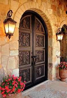 mediterranean front doors - for a Single front door - add blocks with iron work.