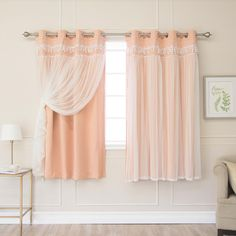 Elegant and sophisticated Lace Overlay Blackout Curtains are a luxurious complement to your existing home decor. The delicate and romantic tulle gracefully drapes your windows, while the underlying panel