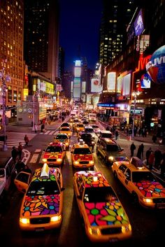 Colorful cabs cruising through Times Square :-)