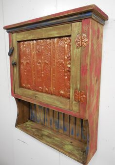 Hello and thank you for stopping by. Here is a large Rustic wall cabinet that could be used in the kitchen for all your jellies and jams. Would