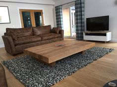 Choose Wooden Large Coffee Table for Contemporary Living Room with Brown Sofas and White TV Cabinet