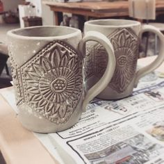 Testing out a new woodblock stamp in slab-built mugs. Feeling like a simple white glaze is going to be the way to go... Can't wait! #stoneware #pottery #ceramics #clay #handmade #handmadeisbetter #ceramica #ceramic #keramik #shoplocal #vancouver #instapottery #potterystudio #iloveclay via: #probeatzpromo