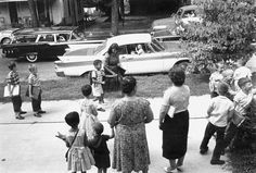 On Sept. 9, 1960, June Campbell walks to Murphey School with her son, Bill, the first black student to integrate the Raleigh schools.