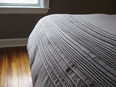 DIY duvet cover from flat sheets...I love the folds at the bottom...