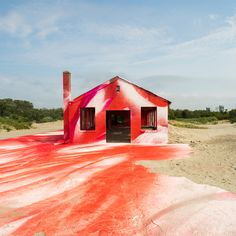 A condemned structure on a New York beach was transformed into an artwork using brightly coloured spray paint by German artist Katharina Grosse this summer.