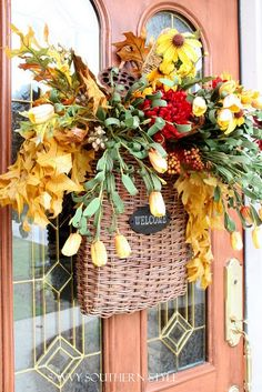 Hang a basket on the door vs a wreath and fill it with seasonal flowers or decorations.