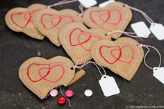 Kraft Paper Stamped Heart Pouches -- these sweet little DIY Valentines can be filled with any number of treats for a fun surprise!