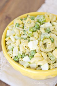 classic macaroni salad with celery, onion, relish, eggs, and peas