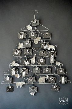 Everywhere & nowhere: Wire – Advent calendar made of wire hangers and when I tamed the wild animals (from a book ; Unique Christmas Trees, Christmas Makes, Noel Christmas, Beautiful Christmas, Advent Calenders, Diy Advent Calendar, Christmas Crafts, Christmas Decorations, Christmas Ideas