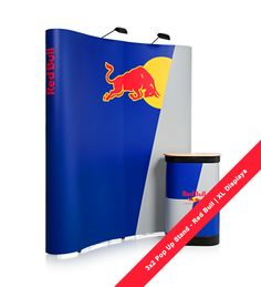 3x2 Pop Up Display Stand. One of a series of 6 exhibition stands we did for Red Bull Energy Drink marketing event. 3 x 2 Pop Up Stands from XL Displays include all print, Pop Up Display hardware, halogen spotlights, counter case and counter to podium conversion kit: folding beech top + graphic wrap. No hidden extras - £437.  #RedBull
