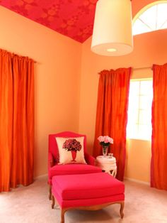 Pink isn't juf for little girls' rooms anymore. This punchy color is much more versatile than you may think. Designer Christopher Grubb chose this vibrant pink-orange color combo to bring a playful touch to this sitting room without making it feel too youthful.
