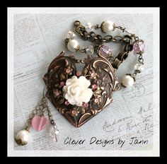 A B'sue Rusty Black Heart is buffed back, a Pinwheel Stamping and Rose are attached to the heart .. Book Chain, pearls and glass beads complete this bracelet .. Clever Designs by Jann .. https://www.etsy.com/shop/CleverDesignsbyJann