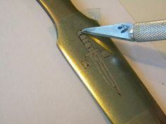 How to easily etch a name or logo into metal. Great for Knife makers.