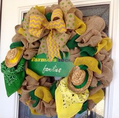 Salute your favorite farmer with this beautiful farm themed burlap wreath! Natural burlap is mixed with bright yellow and green and further