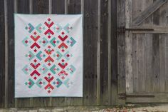 Find the free pattern to make the Snowflake Quilt at WeAllSew. Over the next three weeks, we will create the Snowflake Quilt. During this first week, we will cut our fabrics and stitch up our blocks. During week two, we will assemble the quilt top. And finally, during week three, we will baste, quilt, bind and enjoy! #winter #holiday #quilt #snow #snowflake #free #pattern
