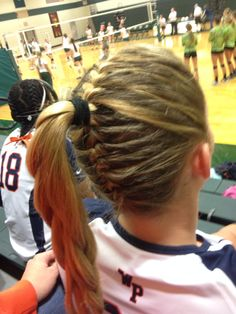 French braids met in the middle for a pony tail
