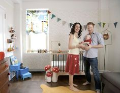 cute crib, cute accent wall, neat vintage chest of drawers, neat flooring, cool toadstools nursery baby
