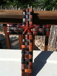 Handmade cross; made from old belts   by Pam Emmons of Central Texas.