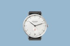 Today, Nomos announces an addition to their line of crisp, contemporary  Bauhaus-inspired watches: the Metro 38 Datum. The changes are subtle, but  make for a clear delineation between the original Metro and this new  iteration. There's no longer a power reserve indicator on the dial,  facilitating the shift of the Nomos insignia from 9 o'clock to 12.  Additionally, the case diameter has increased just a bit, from 37 mm to  38.5 mm.