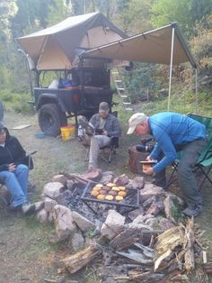 Jeremy enjoying a camping adventure and campfire hamburgers with his J-Series Jeep trailer