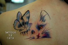 Want on back of right shoulder, close to edge of shoulder so butterfly will merge into future nature half sleeve.  Change cat eyes to green (so it'll show up on my skin)?