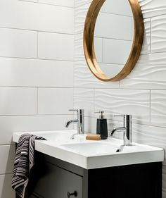 Bathroom Tile Idea - Install 3D Tiles To Add Texture To Your Bathroom | The ripples in these white bathroom tiles used on one wall add a wave-like look to the wall but are close enough to the style of the flat tiles to make the combination work.