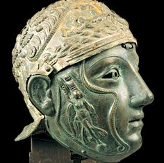 1st century CE.  Superb Thracian Silver helmet with a complete Hinged Bronze face mask. A warrior's equivalent of a bust as the face mask itself is adorned with decorated cheek pieces.  Found in the sarcophagus of a burial mound in eastern-Thracian  Bizye (Vize, Turkey).  Cheek pieces show the goddess Nike carrying the spoils of war.