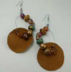 Wire Wrapped beaded Leather Earrings  WWW.AFENICOLLECTIONS.COM    - #handcraftedaccessories#diy#customfashion#customdesigns#uniqefashion#trendyfashion#affordablefashion#fashion#fashionaccessories#leatheraccessories#supportblackbusiness#wearableart#instafashion#buyblack#instastyle#instadaily#instagood#style#photooftheday#stoneearrings#earrings#instafashion#woodaccessories#woodearrings#affordableearrings#jewelrygram#jewelrydesigner#jewelryaddict#beauty#design#style#fashionjewelery