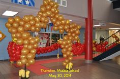 "Middle School 8th Grade Dance Hollywood theme. Student entered through a red carpet lined with red balloon ""velvet"" ropes and a balloon star arch."