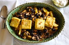 This braised tofu is infused with flavor from the garlic sour cream sauce, cremini mushrooms, sweet tart cherries and golden potatoes.