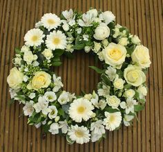 A cluster wreath is ideal for friends or family, the grouped arrangement is best when there are numerous sympathy cards, so each cluster can have its own personal message attached. Elegant white and cream wreath with roses, gerbera, freesia and lisianthus Arrangements Funéraires, Funeral Floral Arrangements, Church Flowers, Funeral Flowers, Wedding Flowers, Sympathy Flowers, Sympathy Cards, Gerbera, Wreaths For Funerals