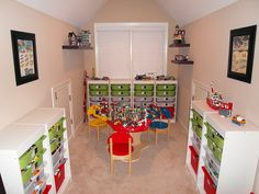 Ultimate Lego Room.  I need to head to IKEA, like now. If I did the Trofast system like this in the playroom, it might actually provide enough storage for the boy's Legos..... Like shelves for display of favorite sets too. Also, for 'prints', use the Lego art that I pinned earlier.