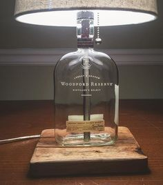 Great googily moogily! Looook at that reclaimed oak base! This was one mighty piece of wood! I had a little bit of a tough time drilling my forstner hole on the bottom. It was wellll worth it! Love everything about how this looks! Always a pleasure working with a @woodfordreserve bottle! #bottlelamp #bottleservice #maker #makersgonnamake #makermovement #whiskeybusiness #whiskey #bourbon #ilovelamp #reclaimed #upcycled #imake #garageworkshop