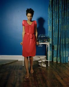 Corinne Bailey Rae wearing an adorable red dress. she's amazing