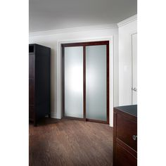 Add a touch of classy style to any room with the Sliding Frosted Glass Fusion Door with Chocolate Frame. This sliding door features a chocolate finished aluminum frame with frosted opaque glass panes
