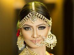 Indian Bridal Jewelry - Meenakshi Dutt Makeovers | WedMeGood | Beautiful Bride in Gold Earrings, Maatha Patti and Nath #wedmegood #indianbride #indianjewelry #jewelry #nath #earrings #maathapatti