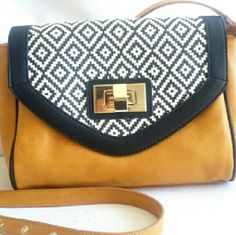 """ALDO   Crossbody bag Beautiful bag in a bright tan color. With some black and white and black tribal design. Inside pockets and one medium zip pocket (working). Adjustable shoulder strap. Metal lock. Thanks for visit my closet    ▶Condition: EUC very little use    ▶Measures: height 7"""" -long 9""""- width 3/ 4 1/2 strap 51 """" adjustable    ▶No trades    ▶Ask any question ;) ALDO Bags Crossbody Bags"""