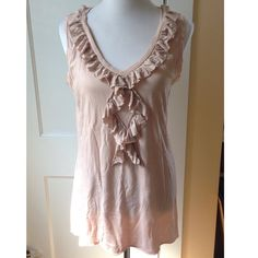 CAbi Blush Pink Ruffle Tunic This lovely blush pink ruffle v-neck sleeveless top by CAbi can be dressed up or down and is ready to be the newest addition to your wardrobe! 55% cotton, 45% modal. Some minor pulling on the fabric (see 4th pic). Gently preloved. CAbi Tops Tunics