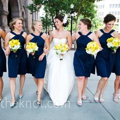 The six bridesmaids kept it simple in knee-length, navy dresses made from crisp cotton sateen. (David's Bridal)